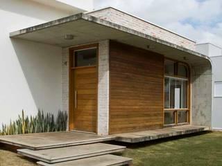 Modern houses by Flavio Vila Nova Arquitetura Modern