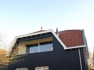Achterzijde woning met nieuwe aan- en opbouw:  Huizen door Kars bouwadviseur en -begeleider