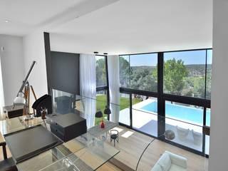 Casa prefabricada modular de hormigón Salones de estilo moderno de MODULAR HOME Moderno
