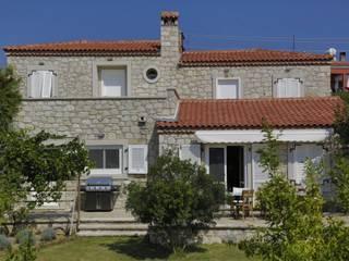 İBRAHİM TOPAL YAPI & MİMARLIK Case in stile mediterraneo Pietra