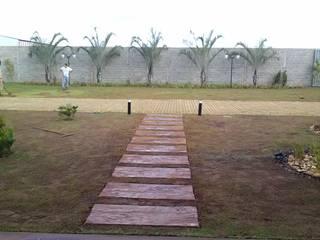 Borges Arquitetura & Paisagismo Tropical style garden