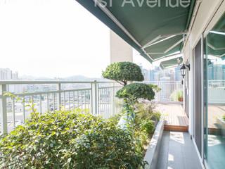 감각적인 패턴과 감성이 있는 인테리어 : 퍼스트애비뉴의  베란다