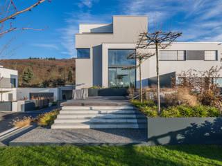 Maisons de style de style Minimaliste par Helwig Haus und Raum Planungs GmbH