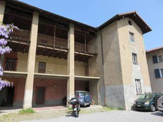INSERIMENTO AMBIENTALE– STABIO - Svizzera Case classiche di KRISZTINA HAROSI - ARCHITECTURAL RENDERING Classico