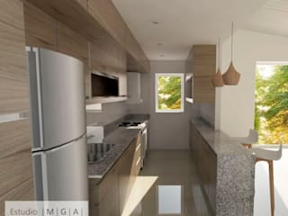 Ampliacion y reciclaje: Cocinas de estilo moderno por ESTUDIO MGA