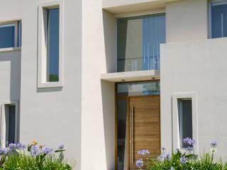 DETALLE FRENTE Casas modernas: Ideas, imágenes y decoración de Parrado Arquitectura Moderno