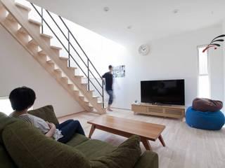 北欧インテリアの似合う家: 遊友建築工房が手掛けたリビングです。