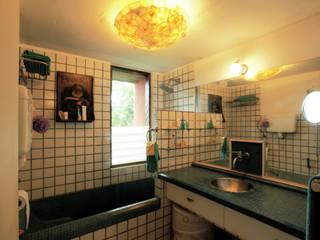 Duplex Apartment, Creativity, Auroville:  Bathroom by C&M Architects