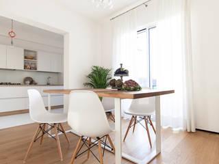 Salas de jantar minimalistas por Didonè Comacchio Architects Minimalista