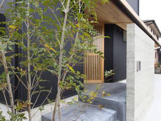 Maisons de style  par 芦田成人建築設計事務所, Éclectique