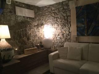 Studio la Piramide Architettura e Urbanistica Mediterranean style living room Stone