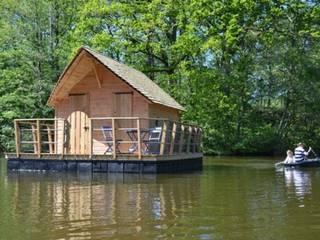 Cabane sur l'eau: Jardin de style  par La Cabane en l'Air