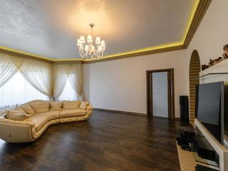 Salas de estar ecléticas por HOME Couture Eclético