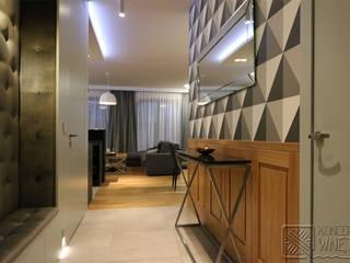 Komfortowe studio w Warszawie Nowoczesny korytarz, przedpokój i schody od Koncepcja Wnętrz Nowoczesny