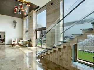 Nikhil patel residence Couloir, entrée, escaliers modernes par Dipen Gada & Associates Moderne