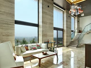 Nikhil patel residence:  Living room by Dipen Gada & Associates