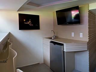 Salas multimedia de estilo  de DIN Interiorismo ,