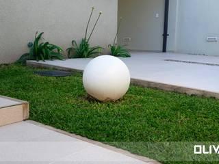 Vivienda 505: Jardines de estilo moderno por Arq Olivares