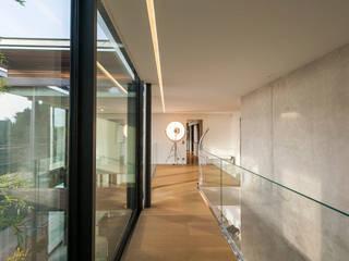 Modern Corridor, Hallway and Staircase by didier becchetti architectes Modern