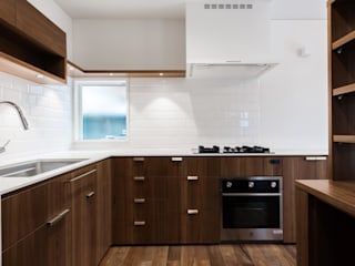 フルオーダーでつくられた造作キッチン: オーガニックスタジオ兵庫株式会社が手掛けたです。