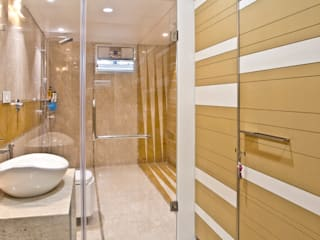 Interiors at Rajhans Maxima apartments,Surat:  Bathroom by Hundreddesigns