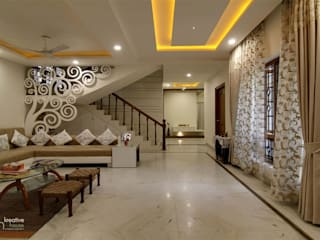 INDEPENDANT HOUSE DESIGNED IN A MINIMALISTIC ORNAMENTAL STYLE,INDEPENDENT HOUSE AT HYDERABAD Classic style living room by KREATIVE HOUSE Classic
