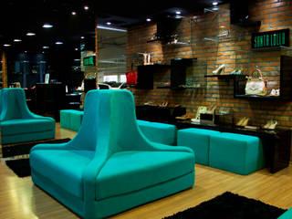 Oficinas y tiendas de estilo moderno de Tumelero Arquitetas Associadas Moderno