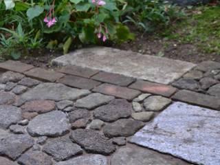 自然素材を使った庭: 株式会社ツガワランドスケープが手掛けた庭です。,和風