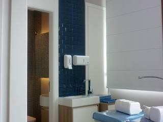 Consultório médico - SBC: Clínicas  por ANDREA DEL MONACO arquitetura e interiores,