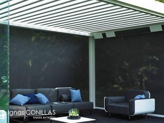 Pérgola Camargue: Jardines de invierno de estilo moderno de CONILLAS - exteriors