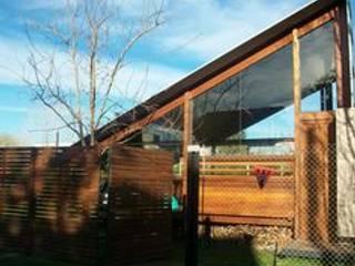 Rumah oleh juan olea arquitecto, Rustic