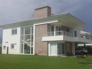 Casas modernas de Biazus Arquitetura e Design Moderno