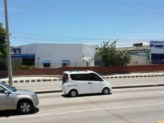 Vitrina automotriz fersautos-Barranquilla:  de estilo  por Arquitectura e Ingenieria GM S.A.S