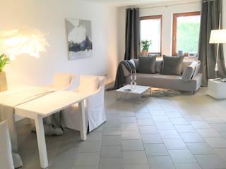 Salones de estilo  de Münchner home staging Agentur GESCHKA, Moderno