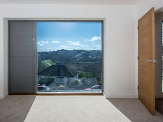 Mallards View, Devon, UK:  Bedroom by Trewin Design Architects