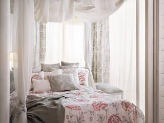 Ropa de cama y cortinas artesanales:  de estilo  de Decoración Andalusí Textil & Tapicería