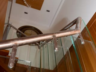 Mahalakshmi Modern Corridor, Hallway and Staircase by TRINITY DESIGN STUDIO Modern