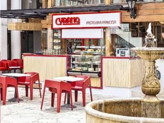 Cyrano Pasteleria: Locales gastronómicos de estilo  por AV arquitectos, Moderno