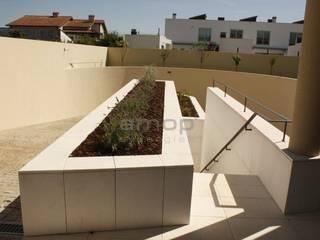 Pedra Mono K, Cobre Muros , Acessórios Paredes e pisos modernos por Amop Moderno