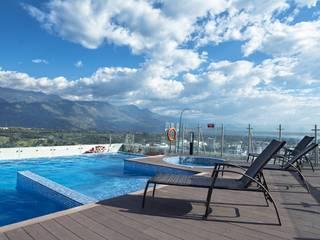 PISCINAS HOTEL ALLURE AROMA MOCAWA - ARMENIA: Hoteles de estilo  por THE POOL MARKET S.A.S