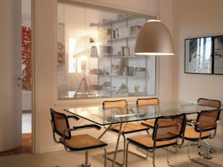 Dining room by Studio Sarpi, Modern