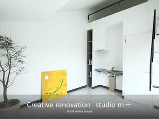 studio m+ by masato fujii Modern dining room White