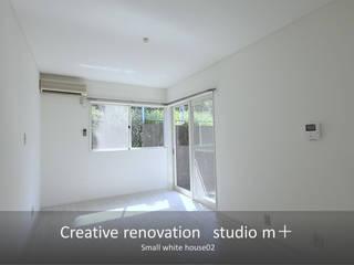 studio m+ by masato fujii Modern living room White