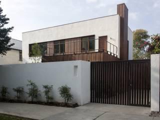 vivienda + taller : Casas de estilo  por PARQ Arquitectura