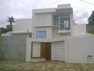 Residência: Casas  por Escritório de Arquitetura Rachel & Lidia
