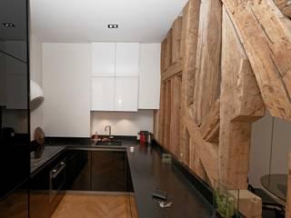 Rénovation d'une cuisine Paris 2ème: Cuisine de style  par Plombier Paris Express
