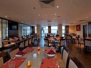 Restaurants de style  par Dynamic Designss, Moderne