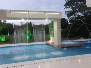 Cada de agua piscina. de homify Moderno Concreto