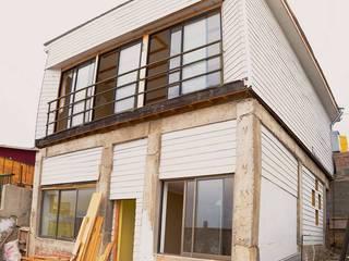 Casas de estilo  de ONG Vivienda Local, Moderno