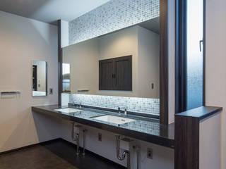 K邸: 一級建築士事務所  馬場建築設計事務所が手掛けた浴室です。